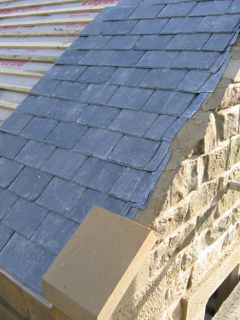 A slate roof with some of the lead flashings also visible.