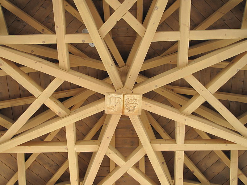 Carpentry and wooden boss of a hall near the departure station of the gondola lift of Samoëns.