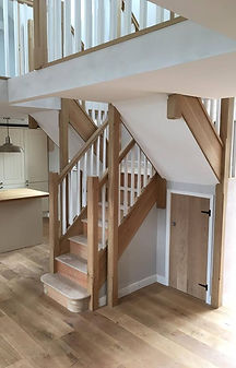 A beautiful oak staircase created with eropean oak banisters, nual posts strings and handrails, mdf Treads and softwood risers and spindles in a recent barn conversion