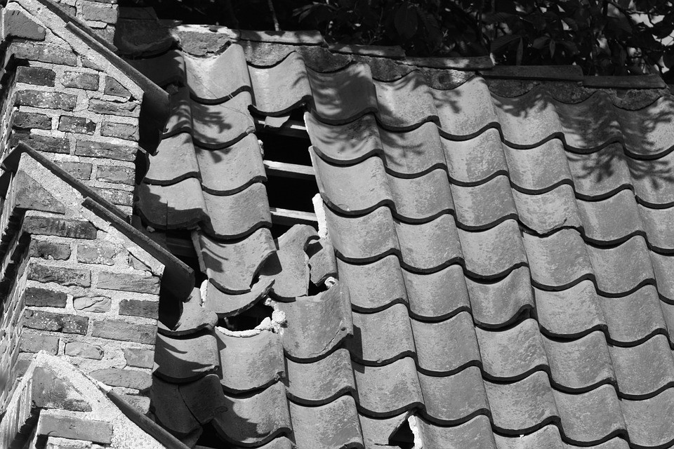An image of a broken roof that needs D & C Roofing to fix it