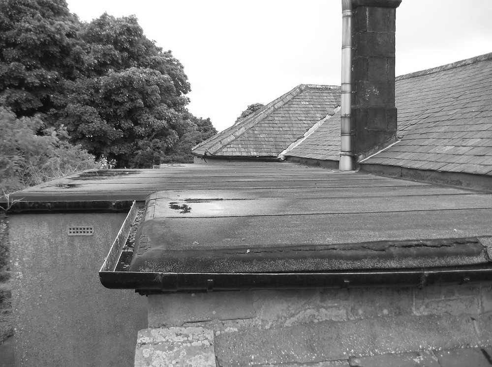 A leaky flat roof that needs replacing by D & C Roofing