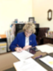 Barb%20signing%20papers_edited.jpg