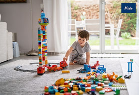 little-toddler-boy-playing-with-lego-tra