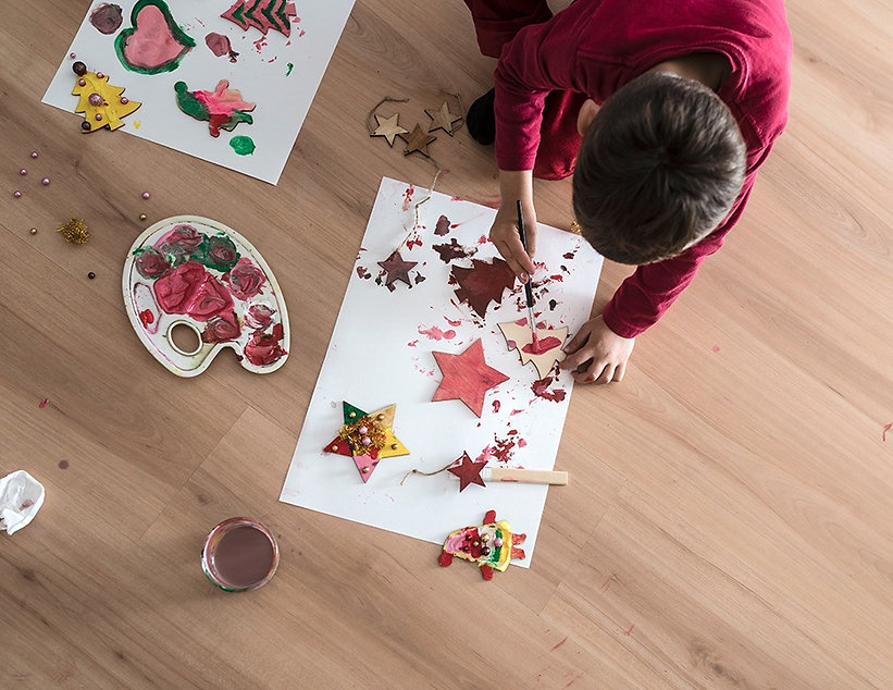 a-kid-doing-christmas-painting-decoratio