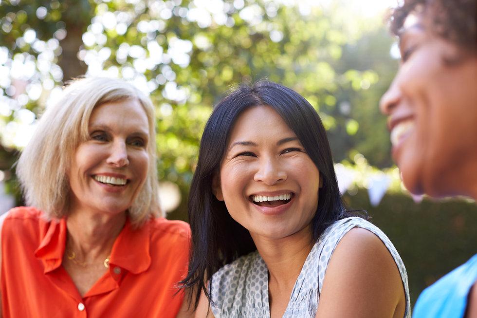 Mature Female Friends Socializing In Bac