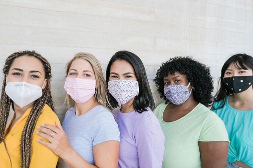 Young beautiful multiracial women standi