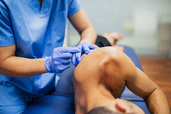 Free photo_athlete geting needled.jpg