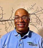 Otis Gordon standing in front of a tree branch.