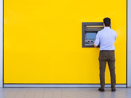 Man using a credit card in an atm for ca