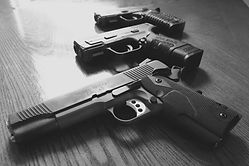 close-up-of-guns-on-table-594190689-59b3