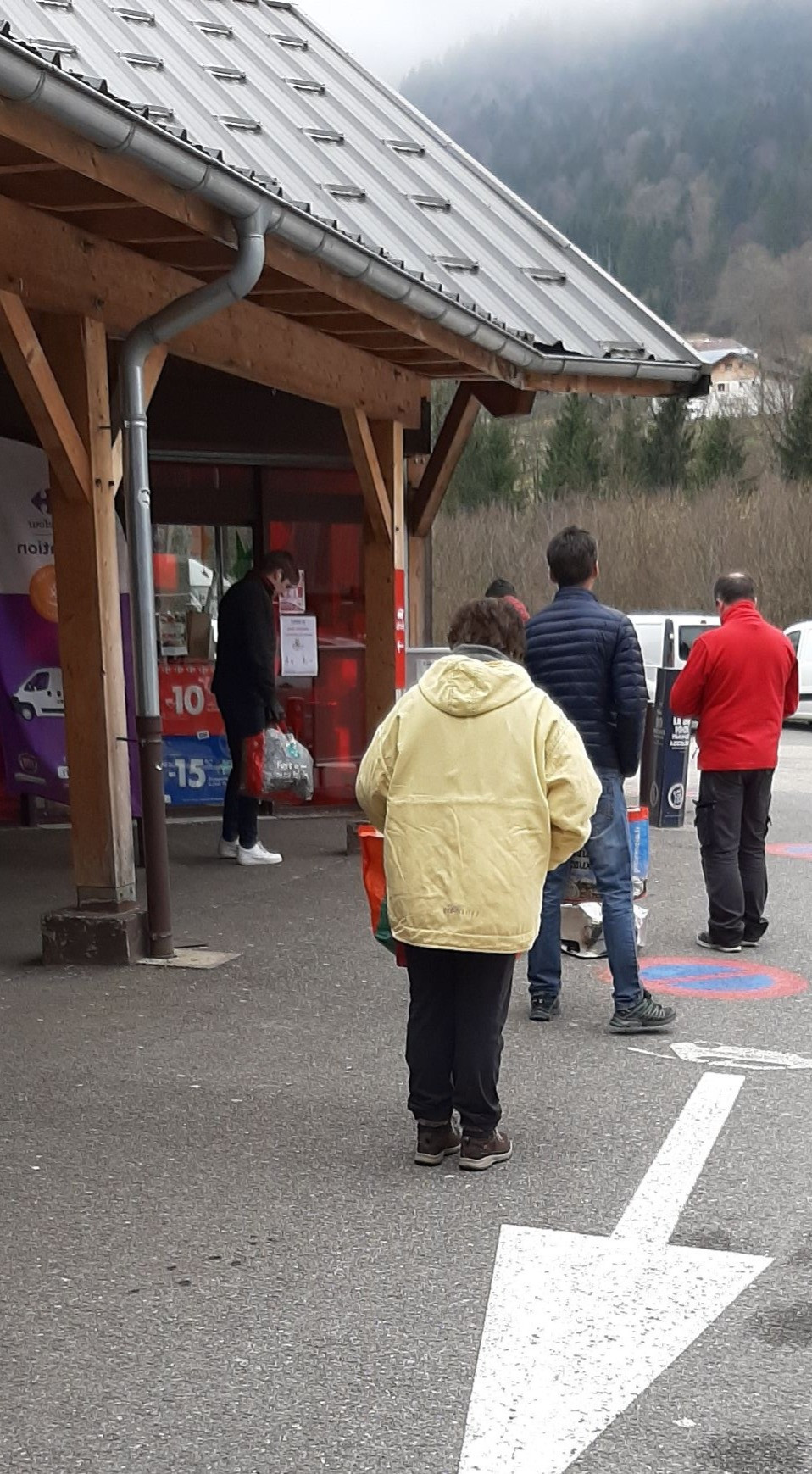 Queuing and social distancing waiting to enter the supermarket