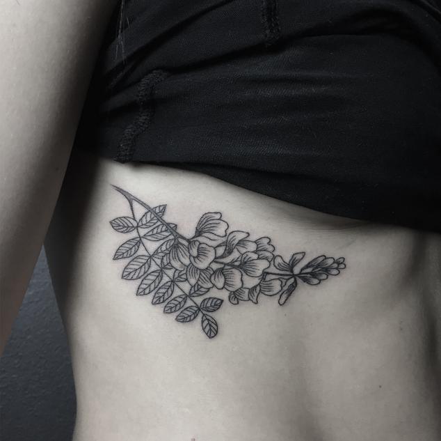 Flower branch tattoo by Nika