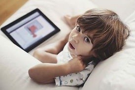 kid on ipad.JPG