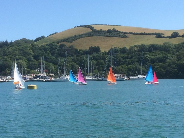 Disabled sailors sailing on the river dart in Hansa dinghies