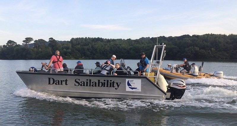 Dart Sailability boats on the river dart with disabled people onboard