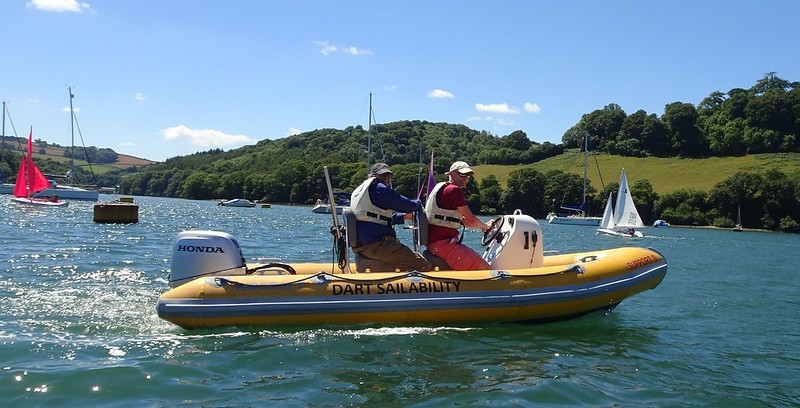 Volunteers on the river dart on support rib