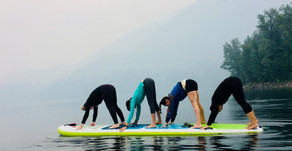 How many ladies can do the downward dog on a SUP?