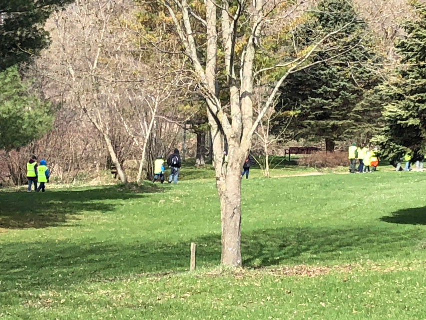 A group of workers on the Linear Park Trail heading to Rambadt Park to help out.