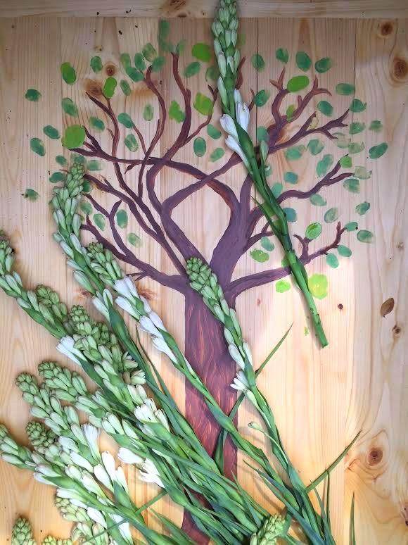 Hand-painted tree on casket lid