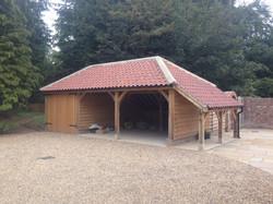 Duna Cottage Oak Framed Garage and Logstore.JPG