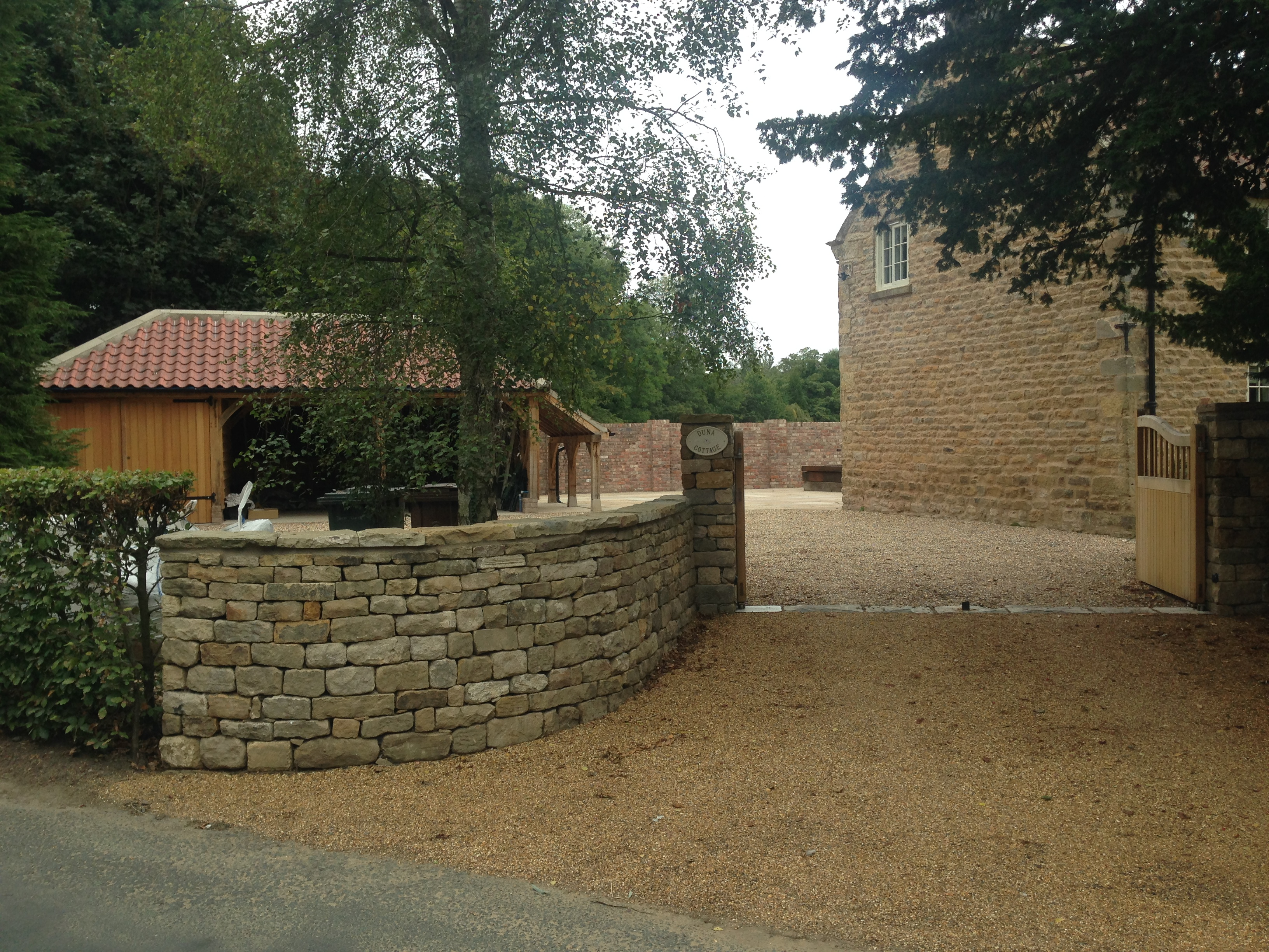 Duna Cottage Drystone entrance wall.JPG