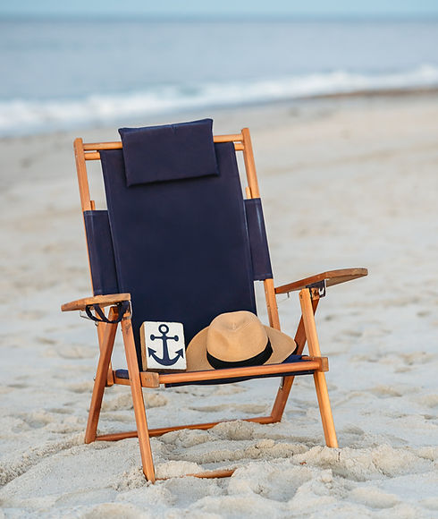 Beach chair with small anchor sign and straw hat