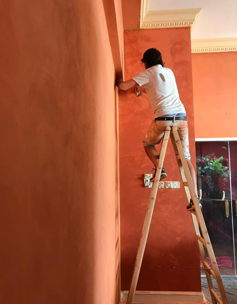 Blood orange venetian plaster stucco paint finish
