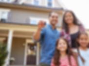 family_holding_keys_to_new_home.jpg