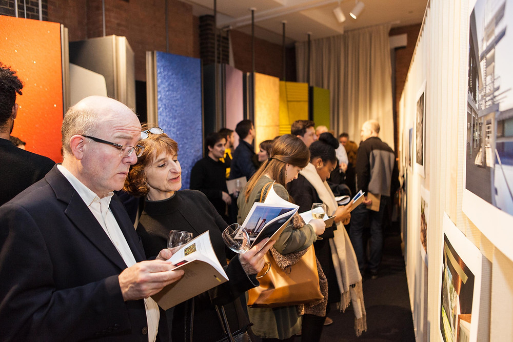 Visitors reviewing the gallery brochure
