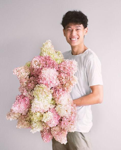 George holding fresh local Chrysanthemum