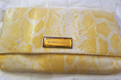 BCBG yellow and white faux snakeskin clutch