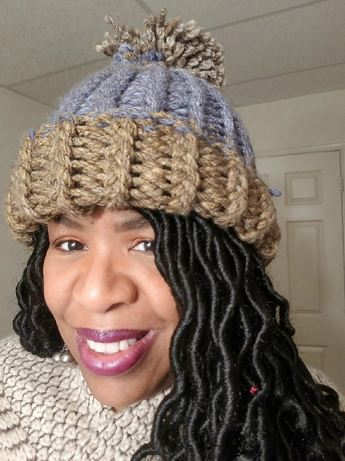 Multi colored tan and blue pom knit hat one size