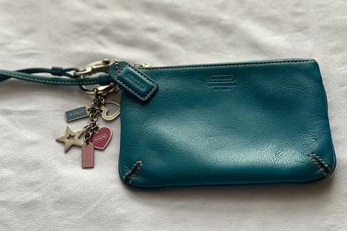 Turquoise blue Coach wristlet with Coach charms