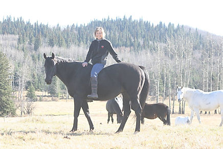 Cathy Thomas riding her horse, Smoke, at Liberty Stables, Millarville, AB. The Luaxophy Method.