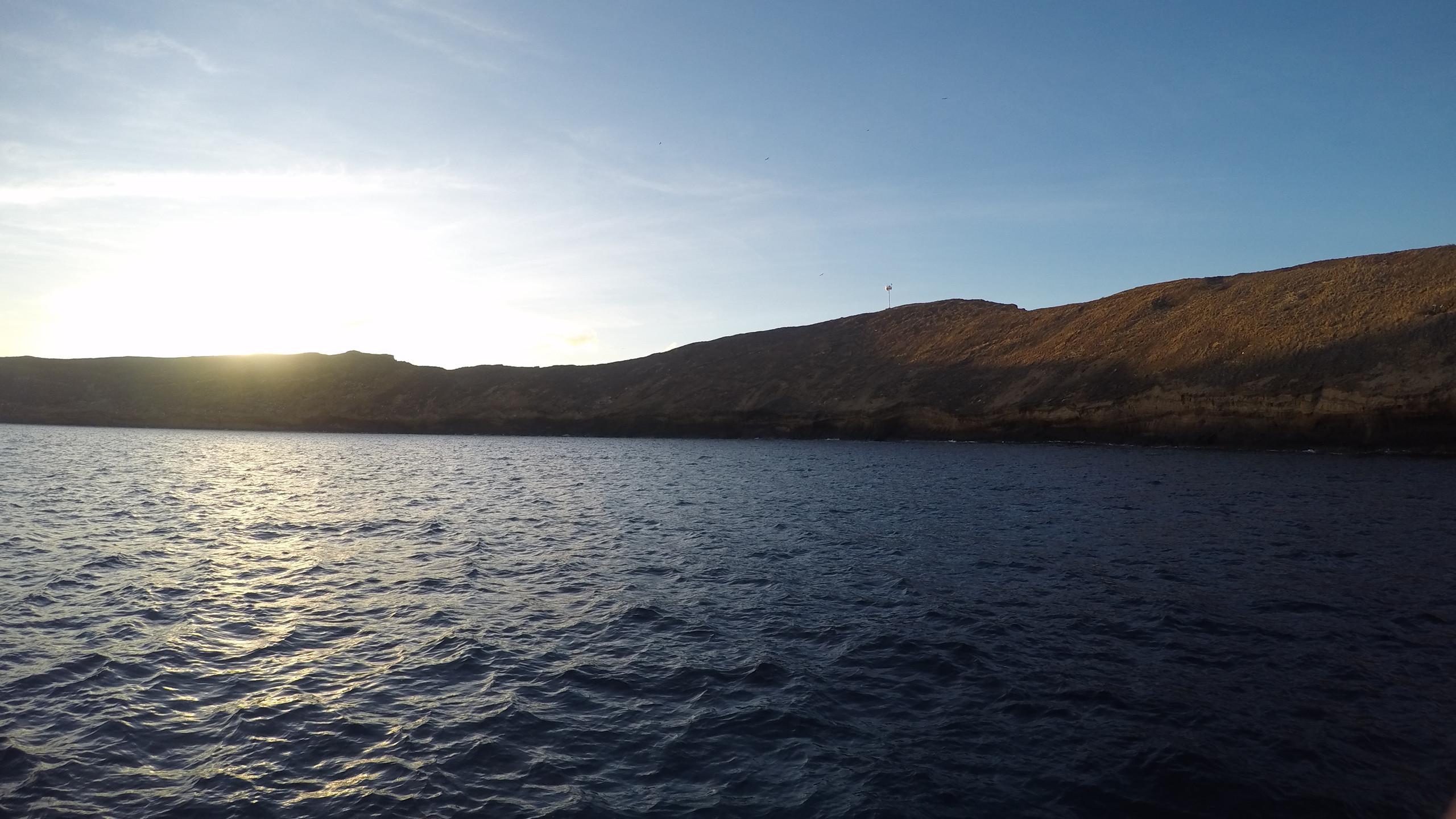 sun rising above Molokini