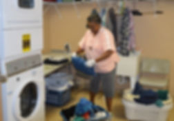 volunteer doing laundry