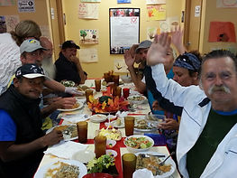 Clients eating their meal and waving at the camera