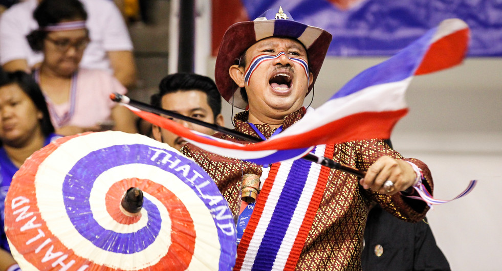 Thai supporters of the women's national volleyball team at Korat Chatchai Hall. Nakhon Ratchasima, Thailand.