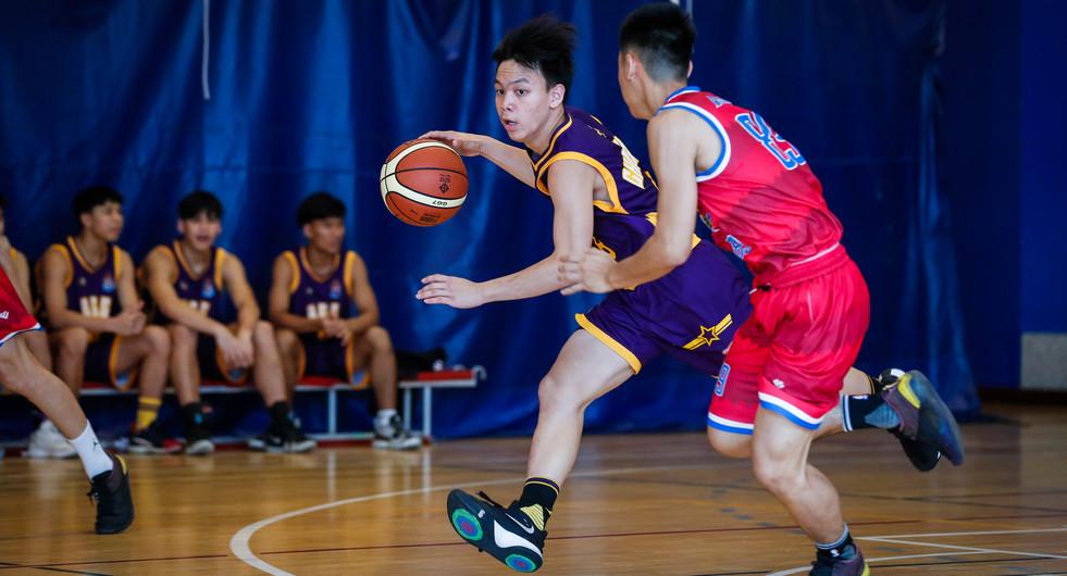 Bangkok Christian College versus Assumption College Thonburi basketball teams in action. Bangkok, Thailand.