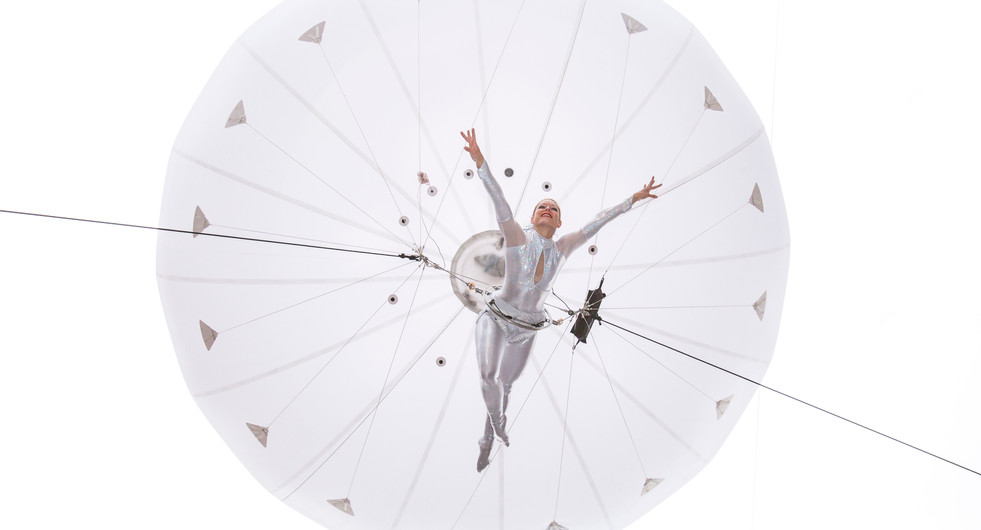Heliosphere aerial acrobatics by The Dream Engine in Piccadilly Circus. London, UK.