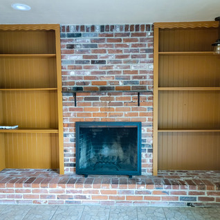 Wood Burnng Fireplace with Built-In Cabi