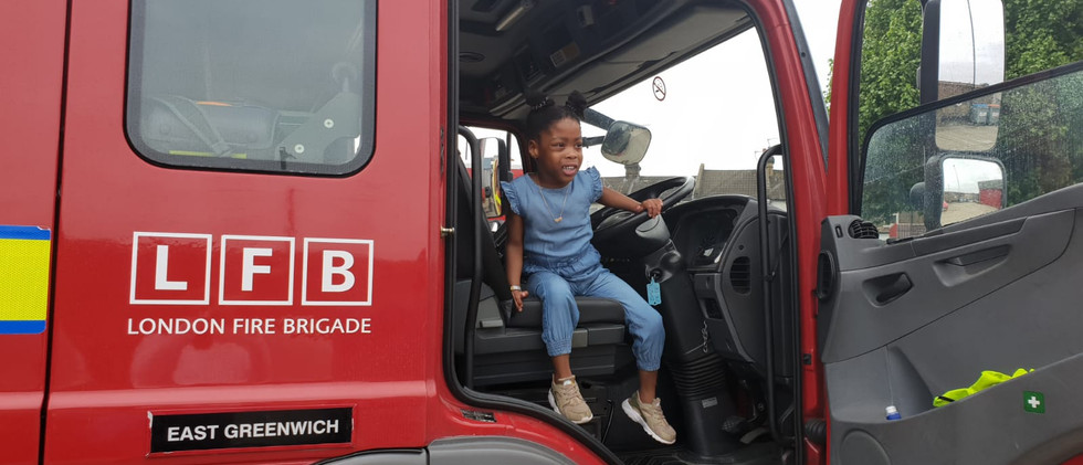Look at me. I am in the Fire Truck.