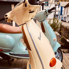 Vespas waiting to go out on delivery