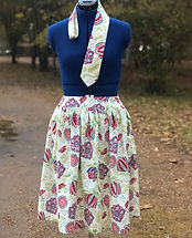 Large floral custom neck tie and gathered skirt