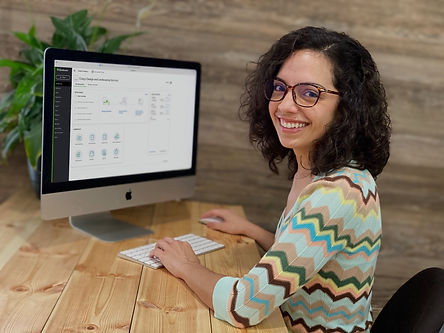 working on a computer setting up QuickBooks