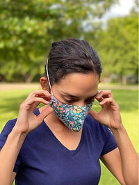 Teal floral face mask with behind the head elastic