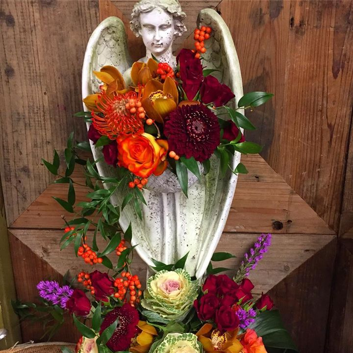 Standing angel with fresh flowers