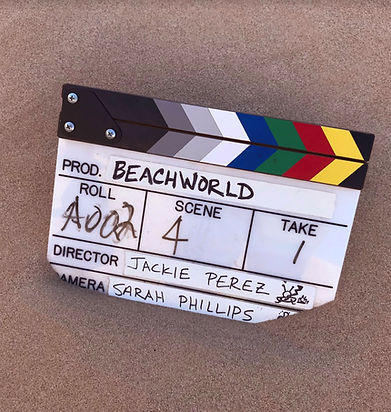 Beachworld film clapper in sand