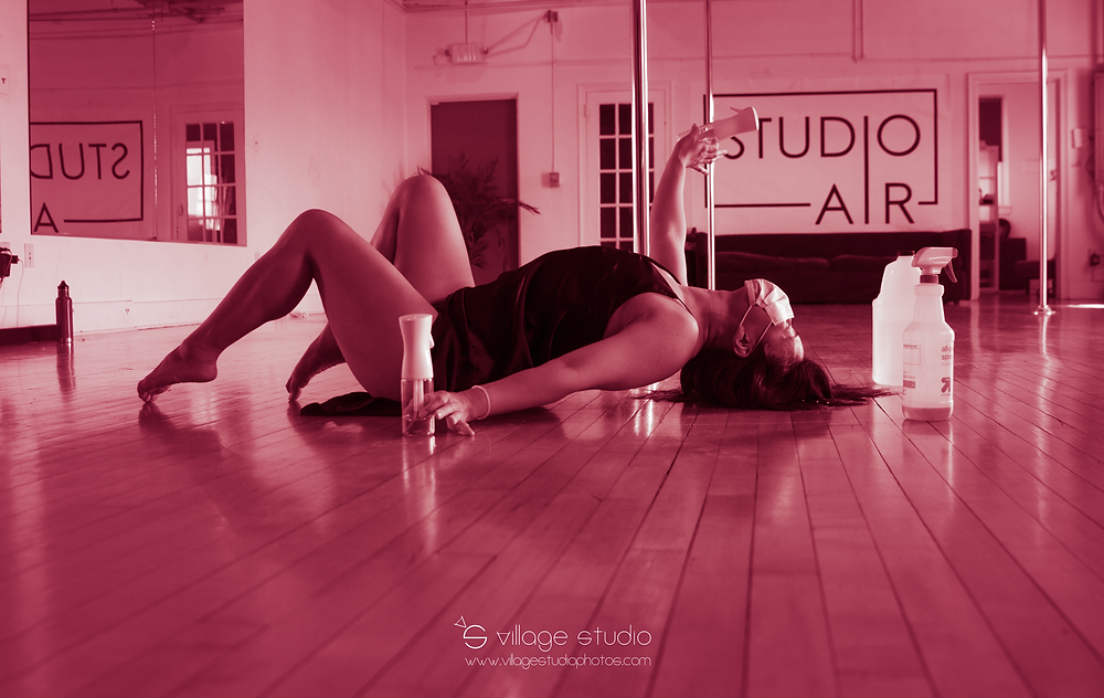 Linda Tsuei interpretively dancing in front of Studio Air sign by Village Studio