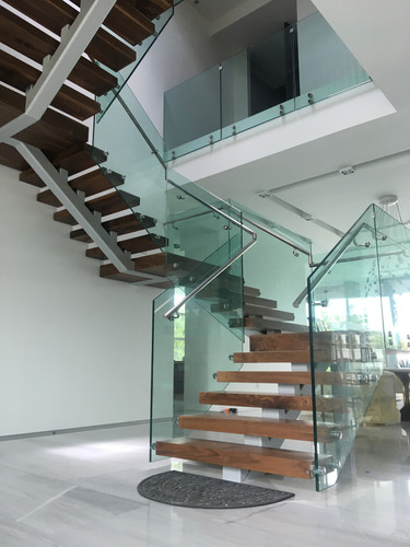 Glass Staircase with wood step covers